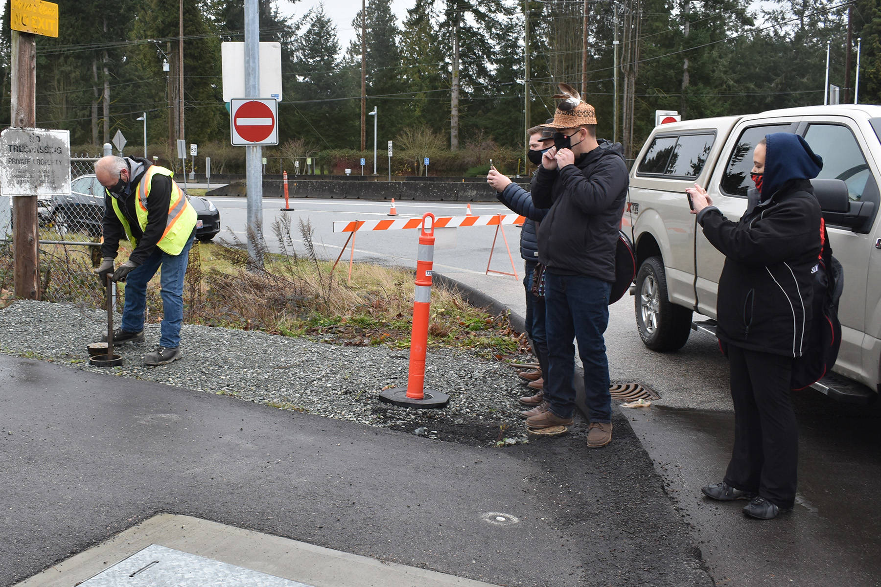 John Boros, of City of Surrey water operations turns on two underground roadside taps last December - one for potable water and one for emergency services - marking the completion of the long-awaited connection between SFN and the Surrey water supply. (File photo)